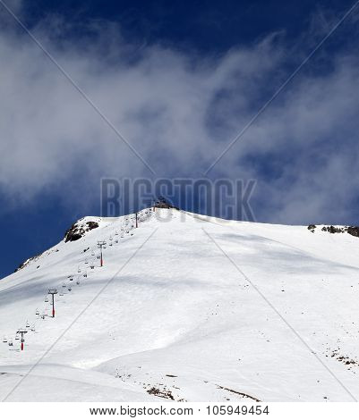 Ski Slope And Ropeway At Sunny Winter Day