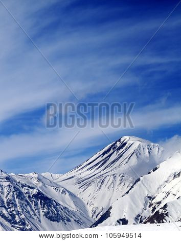 Winter Snowy Mountains In Sun Windy Day