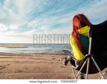 woman sitting on deckchair