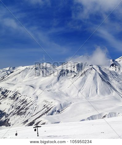 Winter Snowy Mountains And Ski Slope At Sun Day