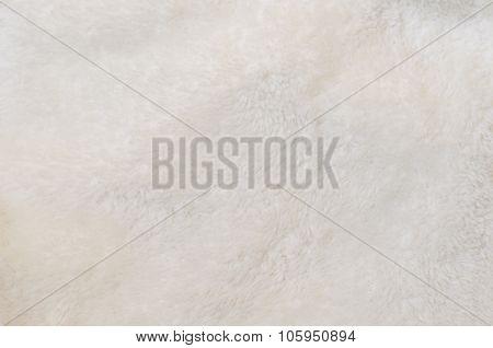 Blurred Background Of Soft Tissue. Beige Background Of Plush Fabric