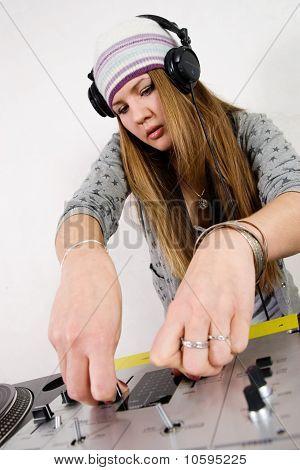 Female Dj Adjusting Sound Levels