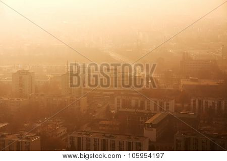 Town with twilight glowing in smoky air