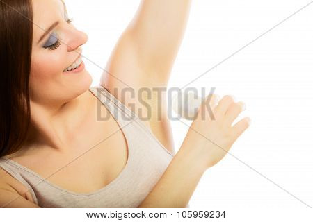 Girl Applying Stick Deodorant In Armpit.