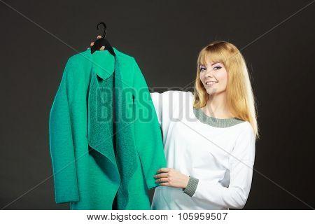 Fashionable Woman Holding Green Coat