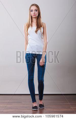 Girl Full Length In Denim Trousers White Top