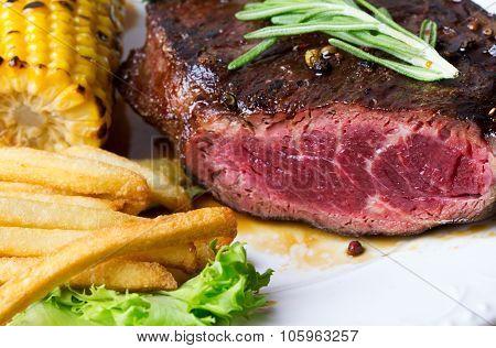 Steak On White Plate