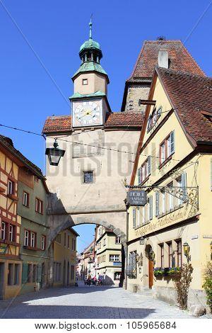 ROTHENBURG OB DER TAUBER, GERMANY - April 24, 2013: Medieval gate and houses wih hotels in Rothenburg Ob Der Tauber