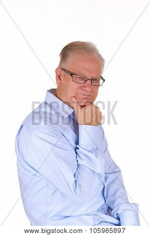 Mature Man Sitting And Thinking.