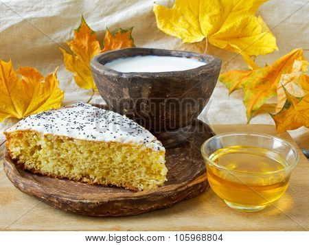 homemade cake with poppy seed, milk and honey