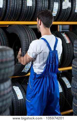 Mechanic check a new tire for car at a tire store