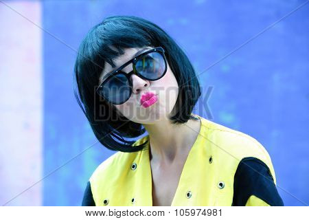 Young woman on the wall background