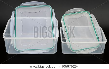 Translucent Storage Boxes With Lips Opened On A Black Background