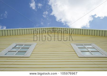 Yellow house with blue sky