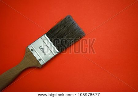 Paint brush on red background