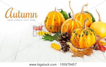 Autumnal pumpkins with yellow leaves on wooden board. Illustration