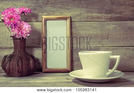 Selective Focus Cup Of Coffee,white Paper Space In Picture Frame,beautiful Pink Flower In Jar On Woo