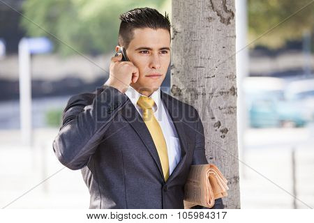 Successful and handsome businessman talking at his cellphone
