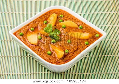 indian potato curry isolated on green mat