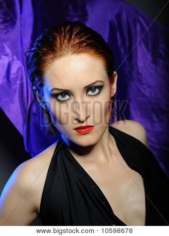 Beautiful Desperate Woman With Perfect Bright Make-up With Red Lips And Dark Shadowed Eyes