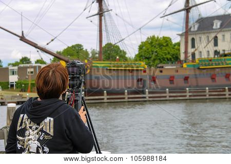 Girl Photographs The Exhibits Of The Netherlands Maritime Museum In Amsterdam