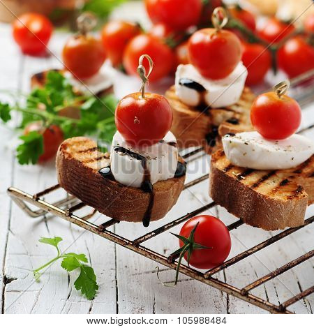 Italian Crostini With Mozzarella And Tomato
