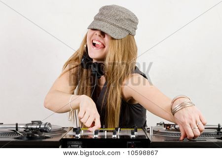 Female Dj Adjusting Sound Level And Pitch