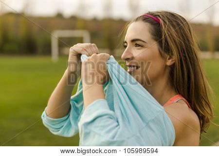 Beautiful woman wearing something warm after exercise