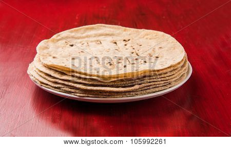indian roti / chapati / phulka / fulka / indian bread made up of wheat flour, isolated