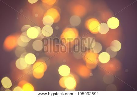 Christmas Background. Golden and brown Holiday glowing Abstract Glitter Defocused Background With Blinking Stars. Blurred Bokeh, vintage toned photo