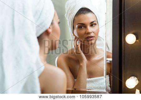 Girl Inspecting Her Skin