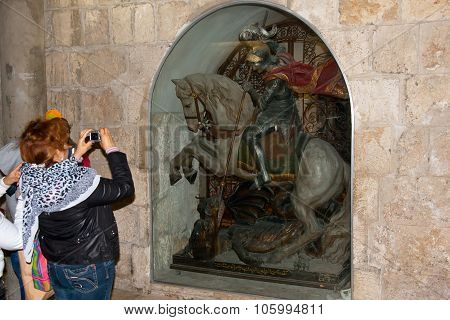 Woman Make Photo Statue Of Saint George In The Church Of The Nativity