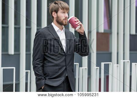 Man Drinking Takeaway Coffee