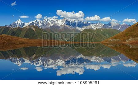 Beautiful Mountain Landscape Reflected In A Lake.