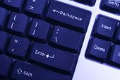 stock photo of backspace  - of dark keyboard with white letters - JPG