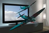 stock photo of spitfire  - spitfire airplanes flying out of 3D television - JPG