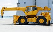 stock photo of boom-truck  - Yellow crane parked on the warship of Thailand - JPG