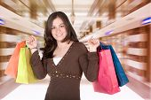 foto of shopping center  - beautiful girl with her shopping bags in a shopping centre - JPG