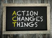 Action Changes Things written on chalkboard poster