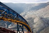 stock photo of dump-truck  - ore conveyor in the open pit mining - JPG