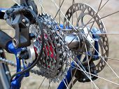 stock photo of bicycle gear  - The mountain bike gears and rear Derailleur - JPG