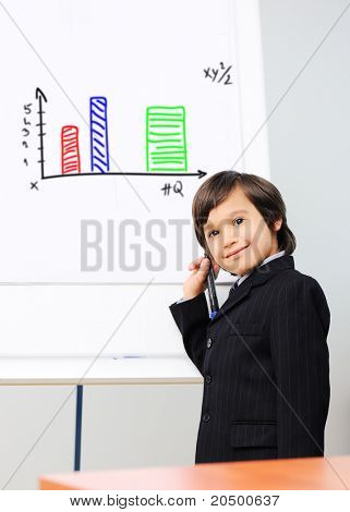 Little kid  drawing a  diagram on a whiteboard, future presentation
