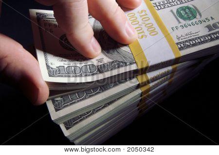 Stack Of Hundred Dollar Bills & Red Dice