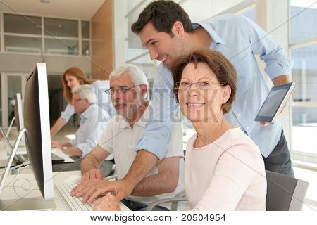 Portrait of senior woman attending computing training