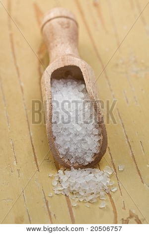 salt crystals in wooden scoop