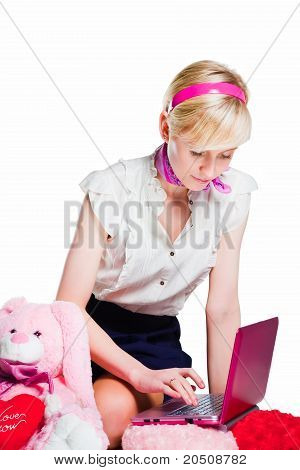 beautiful blond girl working with pink notebook