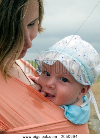 Happy Baby In Sling