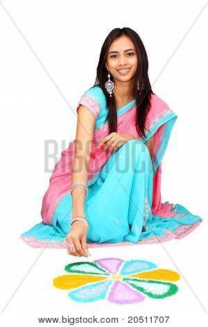 Young Indian Girl Drawing Rangoli.