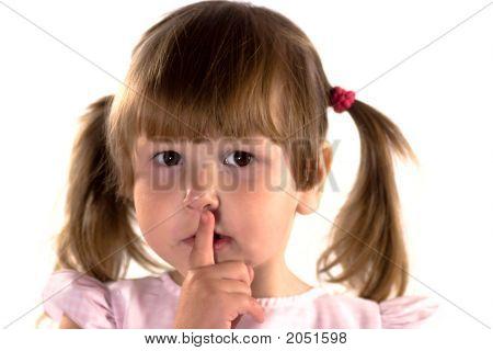 Little Girl Making Sign Of Silence