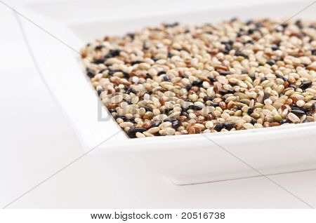Healthy multigrain rice in white ceramic bowl